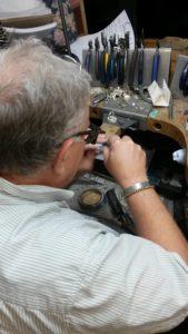 Sam Patania examines Bisbee Turquoise ring